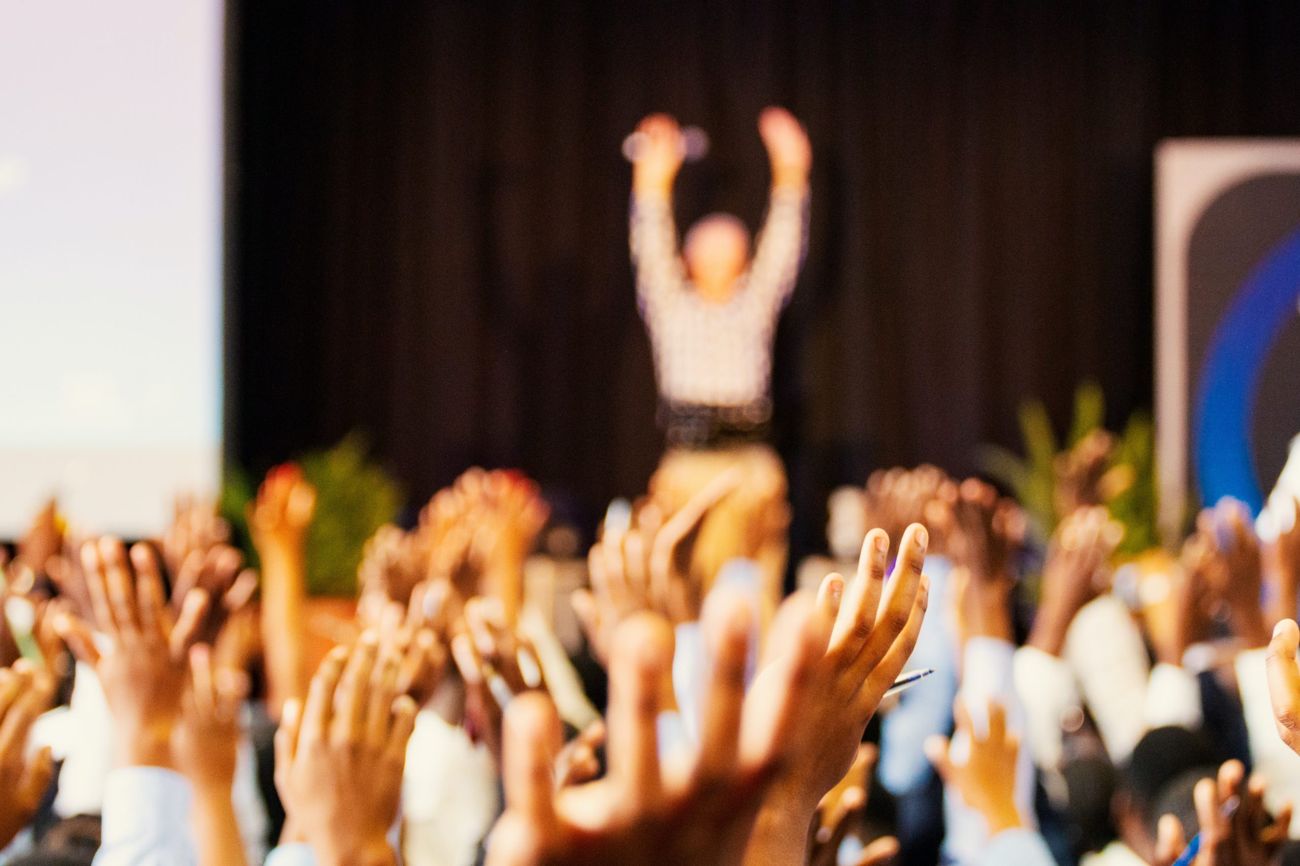 Crowd of people with hands in the air